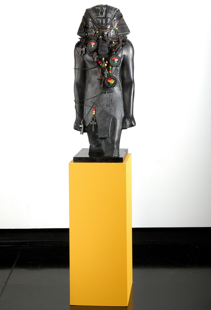 "Fred Wilson, ""Pharaoh Fetish,"" 1993, painted plaster, white pigment, leather and cotton cord, wood and glass, Tang Teaching Museum collection, gift of Peter Norton"