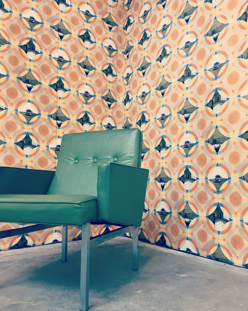 "As part of the exhibition, ""Prototype 1977"" has been mocked up as actual wallpaper, complete with 1970s era furniture."