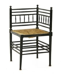 An Aesthetic ebonised corner chair with a rush seat