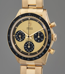 "An extraordinarily rare, extremely attractive, and important yellow gold chronograph wristwatch with ""Paul Newman Lemon"" dial and service guarantee"