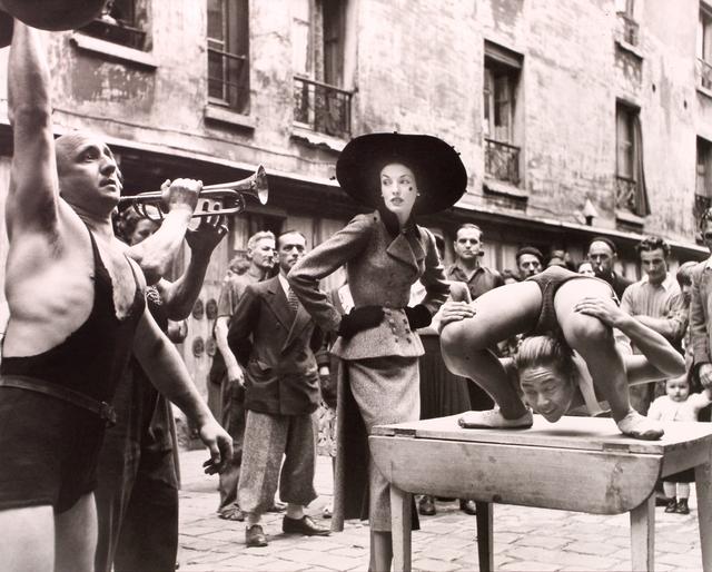 Richard Avedon, 'Elise Daniels with Street Performers, Suit by Balenciaga, Le Marais, Paris, August 1948', 1948, Huxley-Parlour