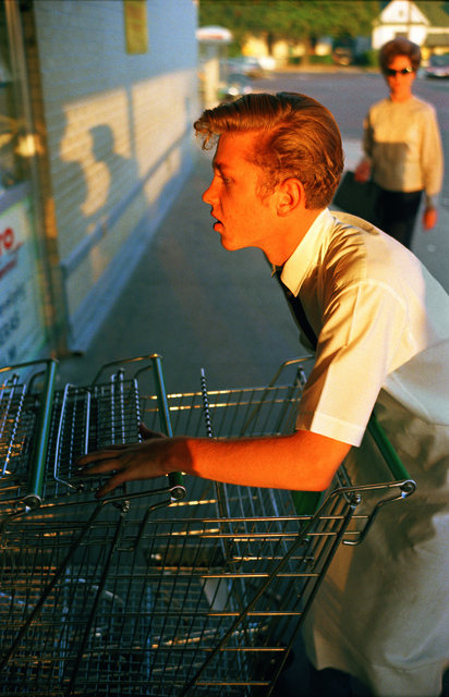 William Eggleston, 'Untitled [Supermarket boy with carts], Memphis', 1965, Musée de l'Elysée