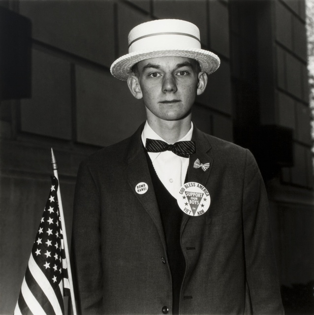 Diane Arbus, ' Boy with a Straw Hat Waiting to March in a Pro-War Parade, NYC', 1967, Edwynn Houk Gallery