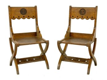 A pair of oak hall chairs