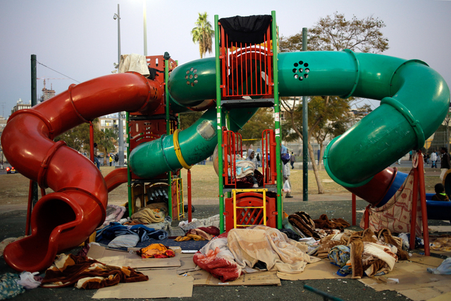 , 'African asylum seekers sleep in a public playground in Southern Tel Aviv. Many asylum seekers arrived at the southern neighborhoods of the city, leading to tensions with local residents. February, 2014,' 2014, Ronald Feldman Gallery