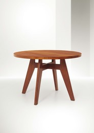 a low table with a walnut wood structure and maple wood top