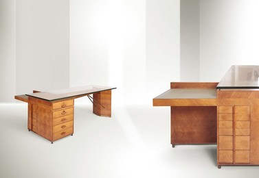 a large desk with a wooden structure, thick glass top and metal details