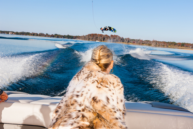 Lauren Greenfield, 'Jackie watches Trevor Hansen, 25, a professional wakeboarder, from a friend's boat, Windermere, Florida, ED 1/5', 2010, Telluride Gallery of Fine Art
