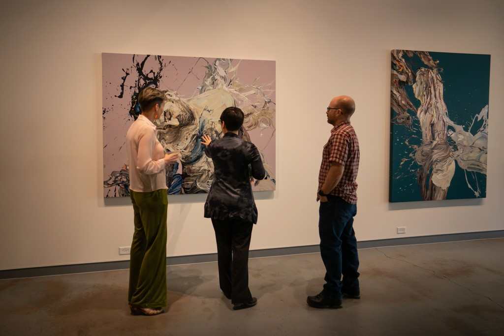 """Gallery staff and visitors discuss """"Transcription 48 (Endeavor)"""" at the opening reception"""