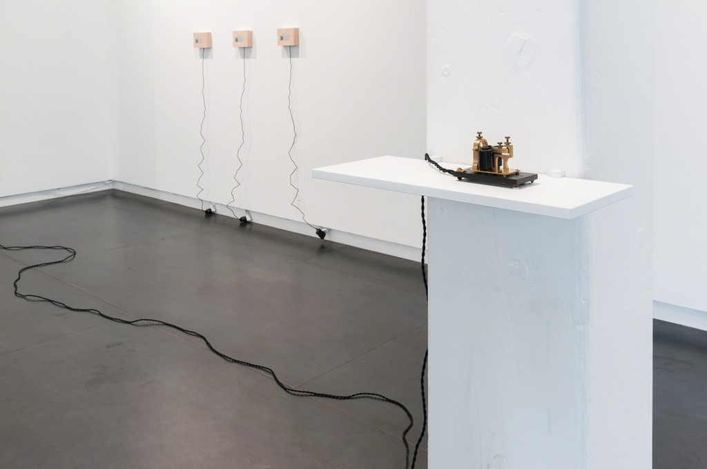 Foreground: Brian House, A Question of Style, 2015, installation (vintage Western Electric telegraph sounders, electronics, wire)
