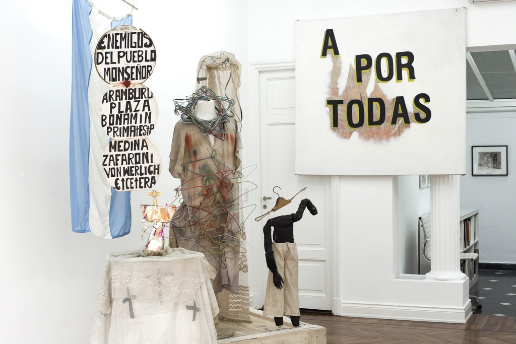 "Exhibition view. On Front, Batato Barea's installation with props from his 1986 performance ""Los Perros Comen Huesos"", on the back, Gustavo Marrone's ""A POR TODAS"". Far on the back: Antonio Berni."
