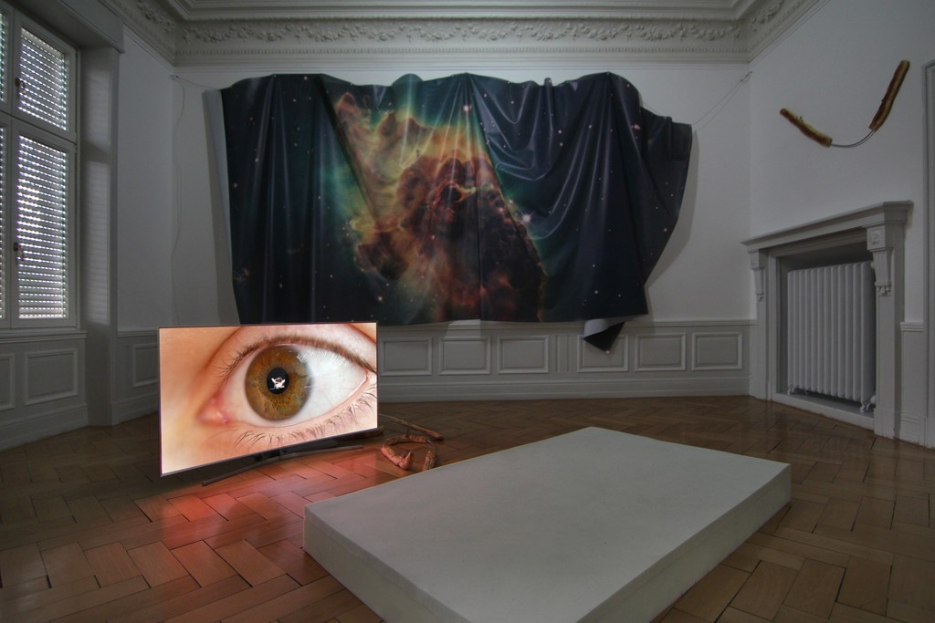 Installation View (from left to right): Countdown Belladonna, Anna, 4k single channel video, 1:22h, 2016 Countdown Belladonna, Bread III, bread dough on custom shaped aluminum rod, 95 x 34cm, 2016 Countdown Belladonna, Bread IV, bread dough on custom shaped aluminum rod, 150 x 48cm, 2016 Countdown Belladonna, Nebula II (Carina Nebula), digital print on mesh, size variable, 2016 Countdown Belladonna, Bread V, bread dough on custom shaped aluminum rod, 118 x 101cm, 2016