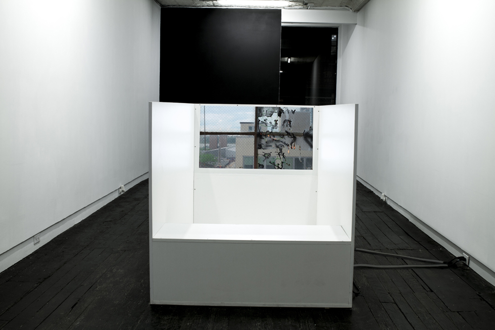 """Installation view of """"Delusion Through Details"""" at LMAKgallery Work on view """"Discern in Reverse"""", 2016 Press board, Formica, two video projections, 2 HD media players, 4 self-powered Yamaha speakers, 2 HD projectors, 2 grip bars, sound-proofing foam, tropical fresh air freshener 144 x 48 x 48 inches Edition of 3, 1 AP"""