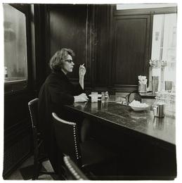Woman at a counter smoking, N.Y.C.