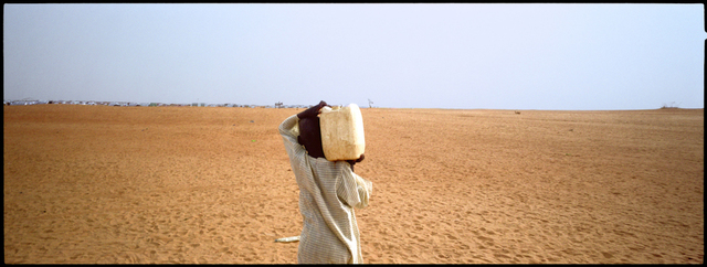 , 'A boy walks back towards an Internally Displaced Persons camp in Darfur.,' 2005, Anastasia Photo
