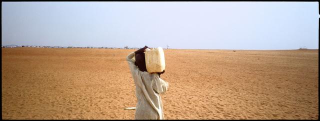 , 'A boy walks back towards an Internally Displaced Persons camp in Darfur.,' 2005, Anastasia Photo
