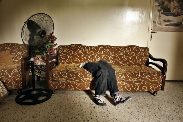 , 'The prosthetic legs of Mohammed, lie on a sofa at the Rashidiyeh camp for Palestinian refugees. Rashidiyeh, Lebanon.,' 2007, Fort Worth Contemporary Arts