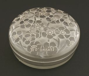 A Lalique moulded glass powder pot and cover