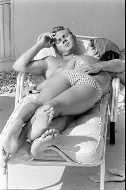 , 'Steve McQueen and his wife, Neile Adams, laying on a chair, California,' 1963, Atlas Gallery