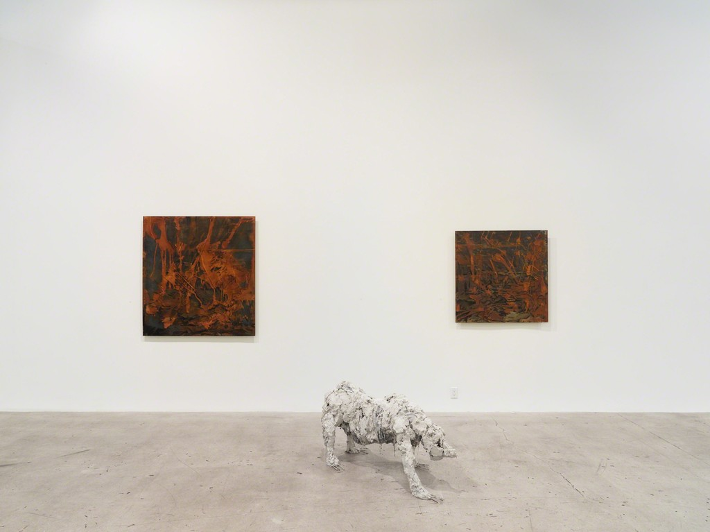 """Installation view of """"Transfigured."""" with paintings and sculpture by Lionel Sabatté"""