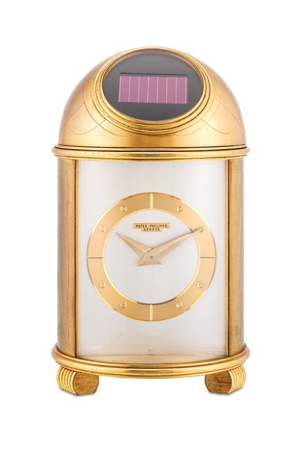 Patek Philippe, 'A fine and rare engraved gilt brass solar powered dome clock with presentation inscription', 1965, Design/Decorative Art, Gilt Brass, Phillips