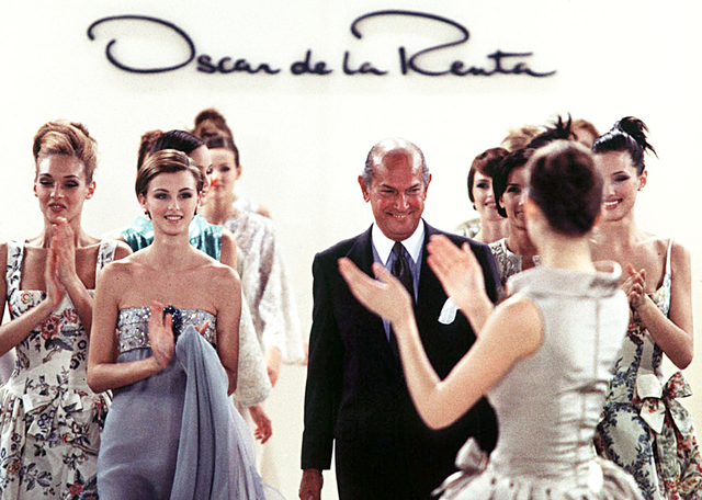 , 'Oscar de la Renta walks the runway with models at the end of his fashion show ready to wear Spring/Summer 1996 in New York.,' 1996, de Young Museum