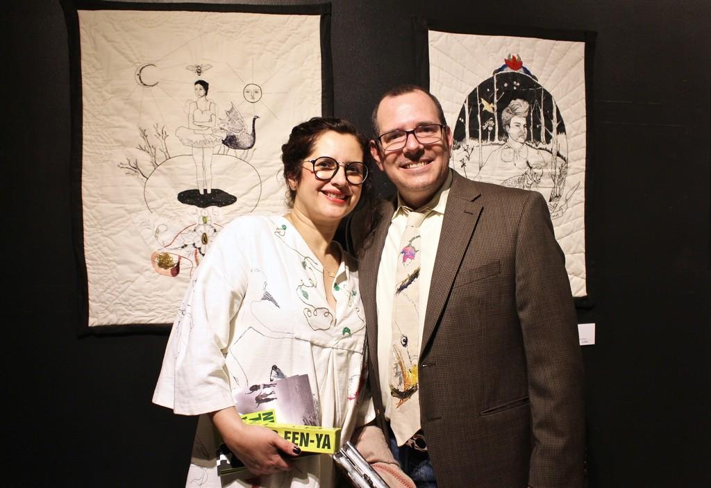 "Artist Karla Caprali with husband and artworks.  ""Awake"" & ""Irradiate"" 2017 Originals"