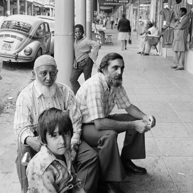 , 'Golam Mehmood Mia (left), Mehmood Mia (right), and Iqbal Abdullah on 14th Street, Fietas before the destruction of the businesses under the Group Areas Act. Jan 1976,' 1976, Goodman Gallery