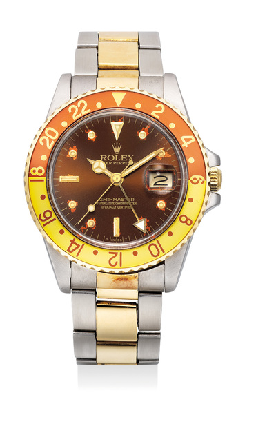 Rolex, 'A fine and attractive stainless steel and yellow gold dual-time wristwatch with bracelet', 1984, Phillips