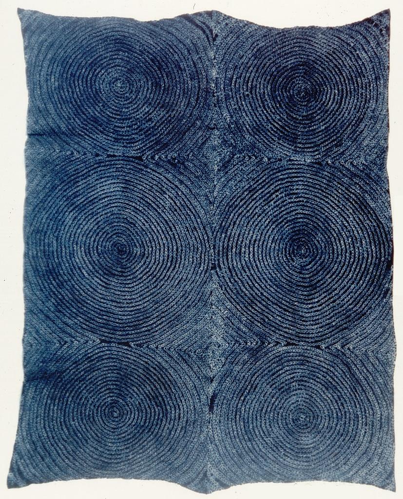 Tye-dyed cloth (adire oniko) with full moon (osu bamba)