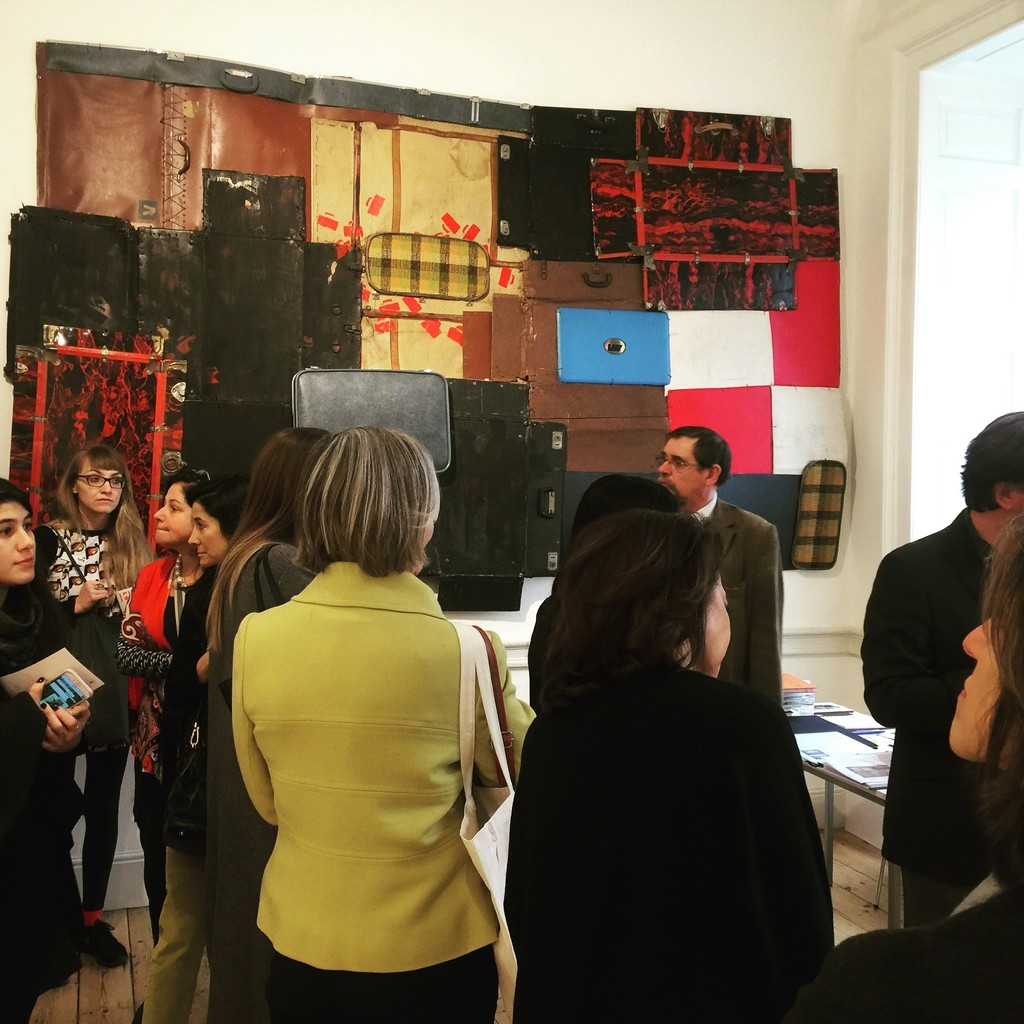 a crowded booth with Bright Ugochuwu Eke's Portmanteau, 2015 in the background.