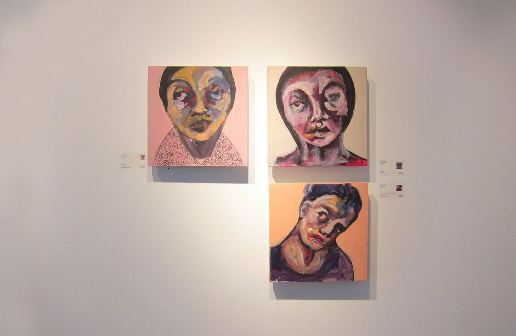 Three expressionist portraits float on the gallery wall, the faces become intimately familiar with the viewer as they take in the exhibition. 