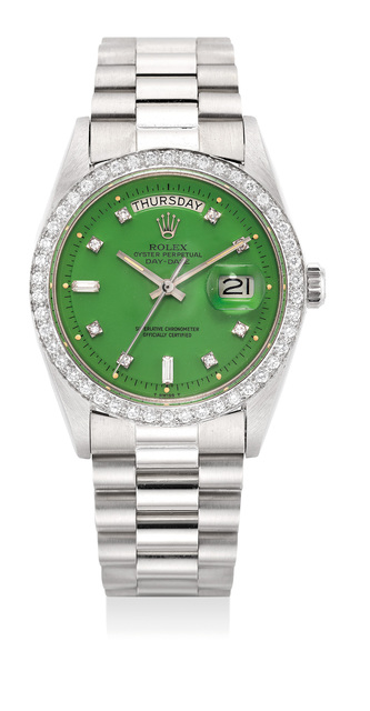 """Rolex, 'A very fine and rare white gold and diamond set wristwatch with green """"Stella"""" dial, day, date, center seconds, bracelet and service guarantee', 1978, Phillips"""
