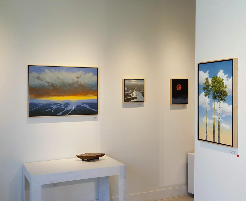 Gallery interior with Denny Holland paintings.