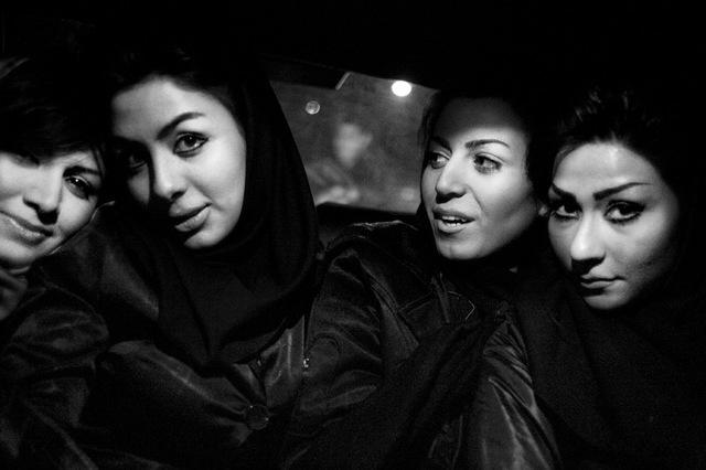, 'Fabio Bucciarelli, Four women on an illegal taxi, Teheran,' 2012, Raffaella De Chirico