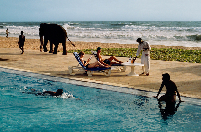 Steve McCurry, 'Tourists lounge poolside, Sri Lanka', 1995, Photography, Digital C-Prints printed on FujiFlex Crystal Archive Super Gloss Paper, Galeria de Babel