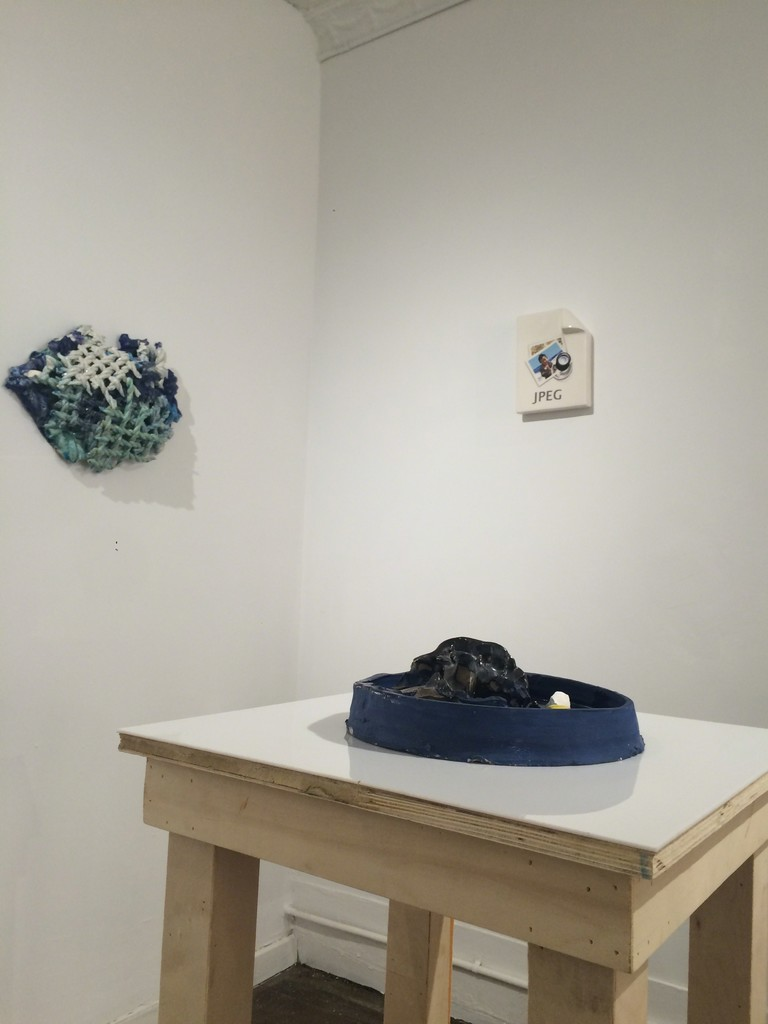 "CERAMICS: A Concept of Function, installation view. Pictured: Alan Belcher, ""_____.jpg;"" Cassie Griffin, ""Charger 10;"" Robert Raphael, ""Untitled (Rope Study)"""