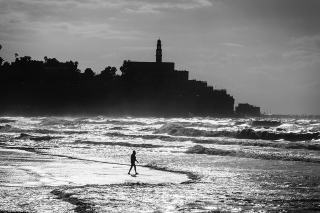 Ziv Koren, 'Jaffa, Israel Dec. 2012 - Israeli man walks into the sea on a winter day, near the Old City of Jaffa.', 2012, Ouro Studio