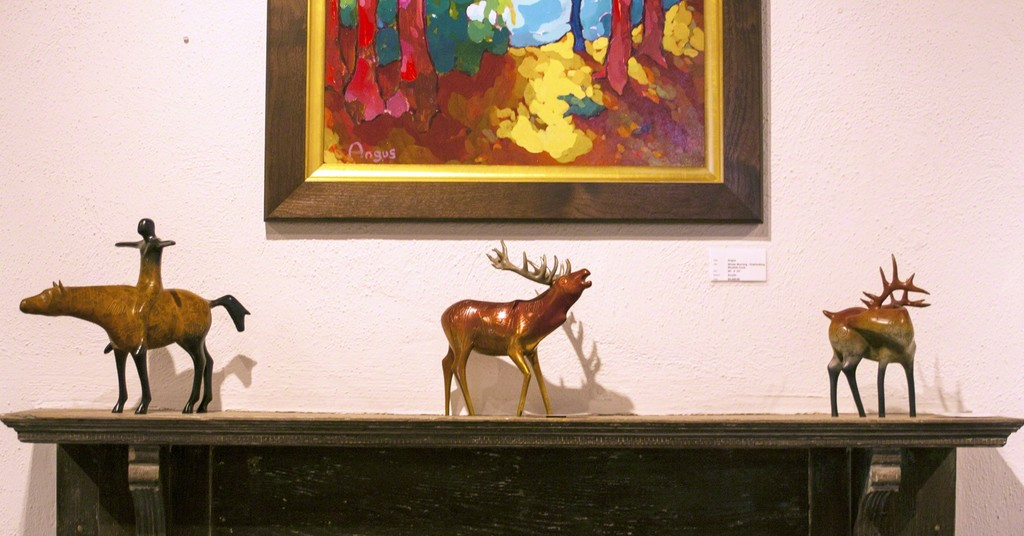 Bronzes by Tobey from left to right:  Freedom, Red Stag and Evergreen Elk.  Angus painting is hung above sculpture.