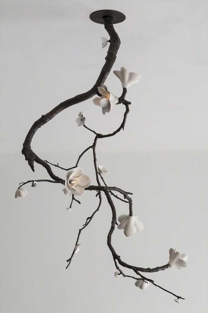 Unique large ceiling mounted branch sculpture in bronze with illuminated white porcelain blossoms.