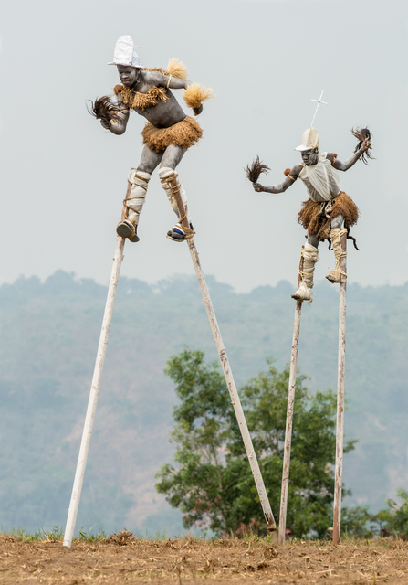 ", 'Pende ""Tall Men Walking"" Stilt Dancers, Gungu, DR Congo,' 2014, THK Gallery"