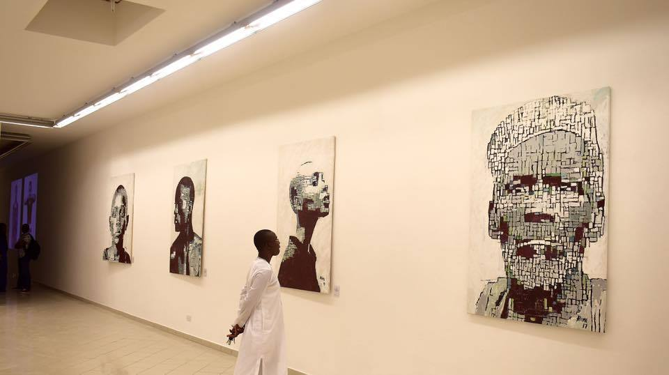 Installation view of pixilated portraits by Alimi Adewale.