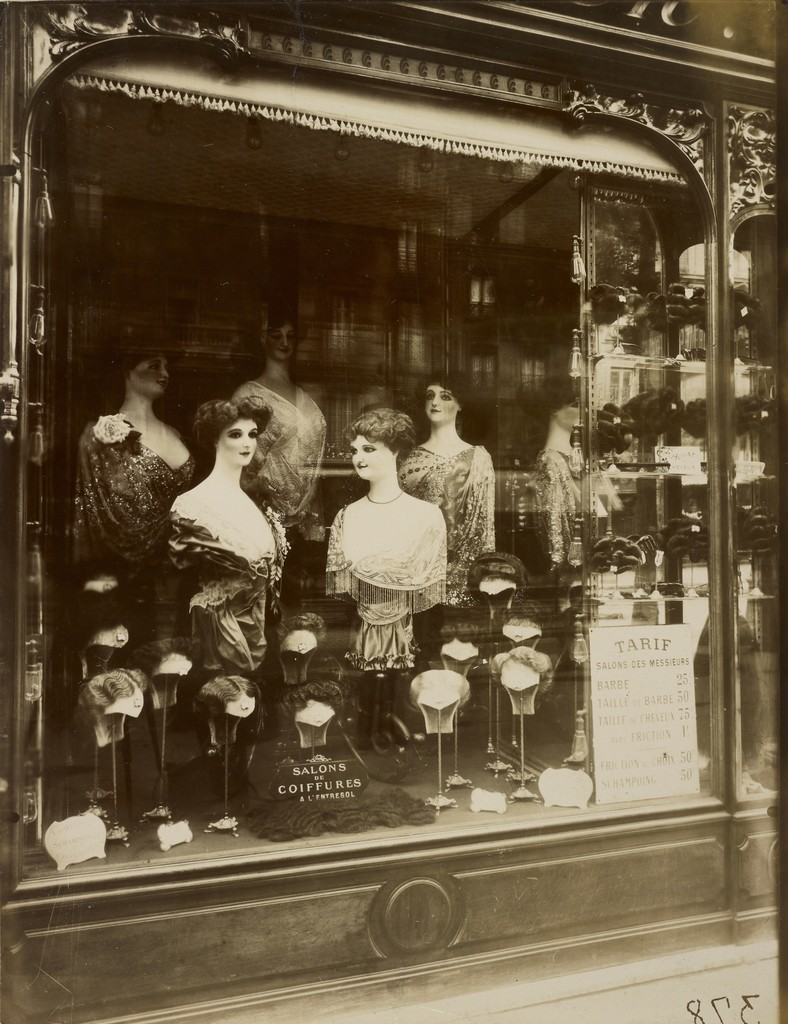 Eugène Atget, 'Hairdresser's Shop Window, boulevard de Strasbourg,' 1912, J. Paul Getty Museum