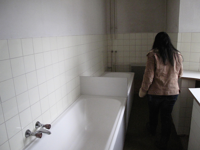 , 'CHRISTINE J., on first visiting the bathroom in the cloister where she had been repeatedly tortured and raped by Catholic nuns. Martinsbühel near Innsbruck, Austria (April 14, 2012),' , Soho Photo Gallery