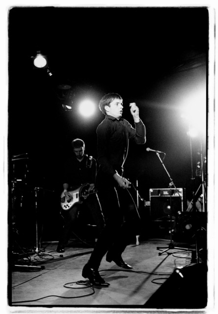 Kevin Cummins, '9. Peter Hook and Ian Curtis, Joy Division. Fac 15: Zoo meets Factory Half Way. Leigh Festival, Lancashire 27 August 1979 ', 2006, Paul Stolper Gallery