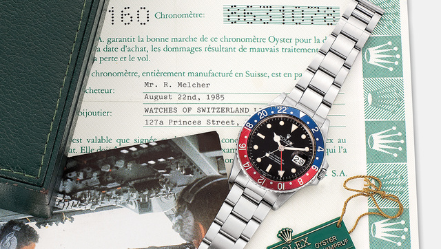 Rolex, 'A fine and rare stainless steel dual time wristwatch with date, spider dial, bracelet, garantie and box', Circa 1984, Phillips