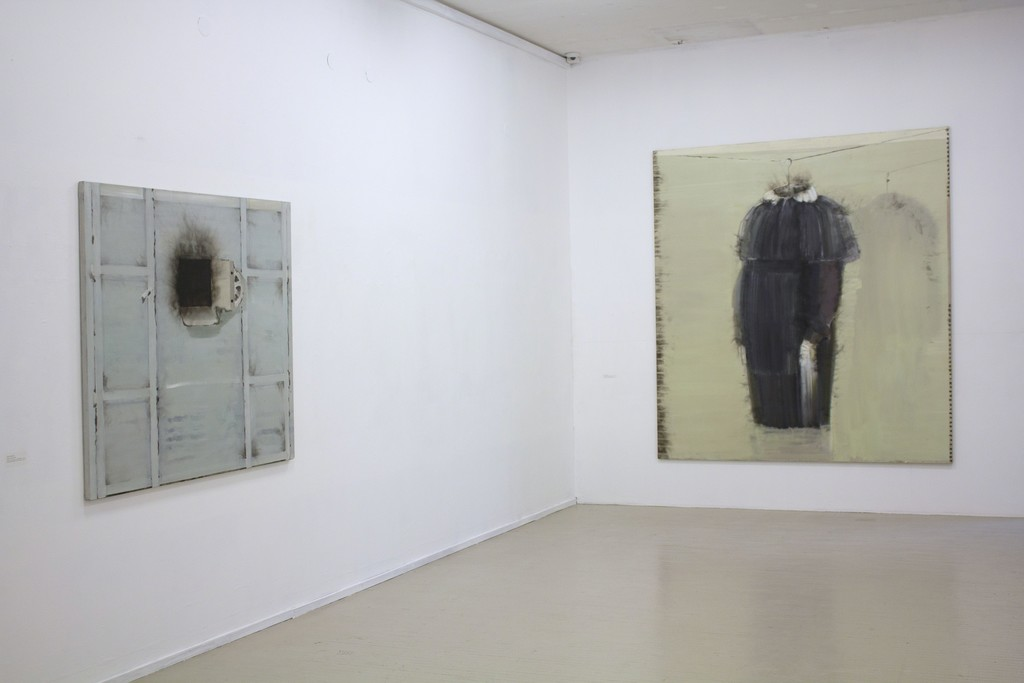 """Fragment of exhibition """"Družba"""". On the left: Jonas Gasiūnas, CASH DESK. 2018. Oil and charcoal (from candle smoke) on canvas, 129 x 143 cm. On the right: Jonas Gasiūnas, A SCHOOL DRESS. 2017.  Oil and charcoal (from candle smoke) on canvas,  230 x 210 cm."""