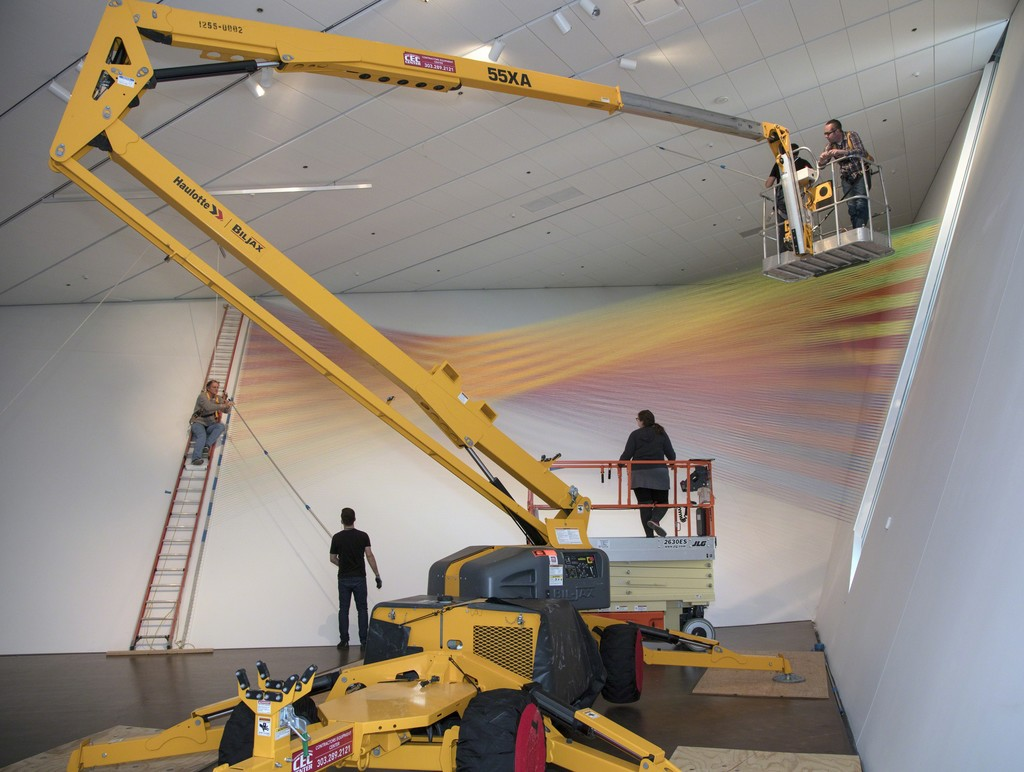 Gabriel Dawe installing Plexus No. 36. Photo by Jeff Wells. Courtesy of the artist and the Denver Art Museum.