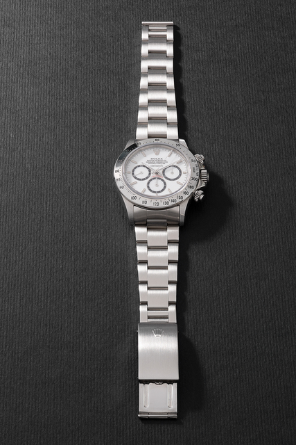 """Rolex, 'An attractive and very rare stainless steel chronograph wristwatch with """"Floating Cosmograph"""" white porcelain dial, bracelet, guarantee, hang tag and presentation box', Circa 1988, Phillips"""