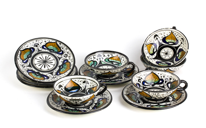 Tea service composed of six cups and six saucers decorated with peacock eye motif